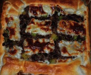 Torta salata di carne, zucchine e speck