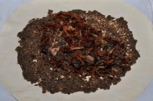 ricoprite il tacchino con il resto dei funghi e con la pancetta